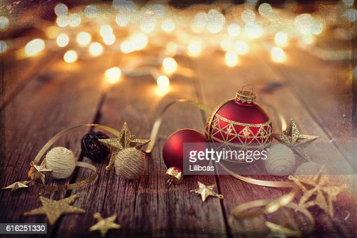 Christmas Ornaments Baubles Ribbon and Lights on Old Wood Background : Foto de stock