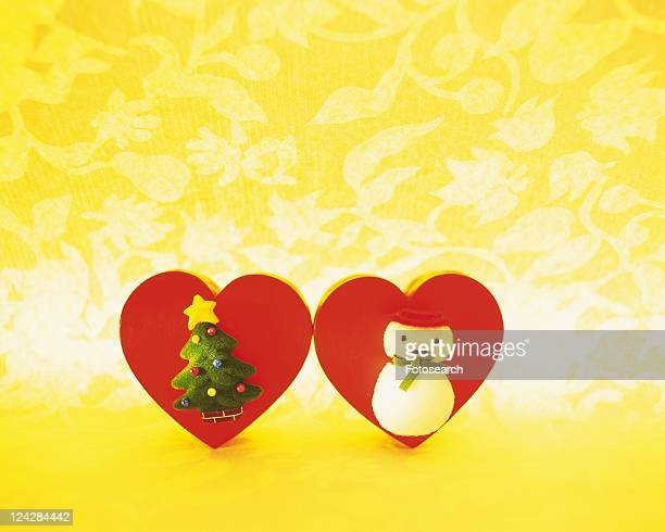 Christmas ornaments, Christmas tree and snowman on heart shaped board, front view