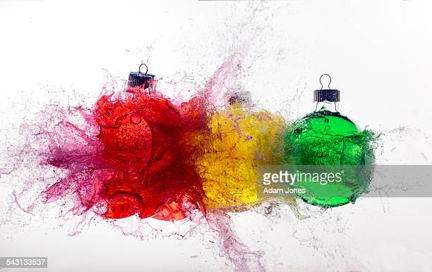 Christmas ornaments exploding from bullet impact