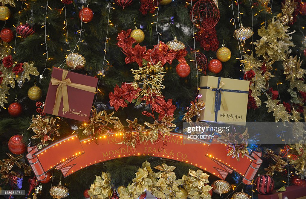 Christmas ornaments hang in a shopping mall in Jakarta on December 22, 2012. Many shopping malls and business centres in Indonesia, the largest Muslim-majority nation in the world, are decorated with Christmas ornaments to welcome Christmas and New Years. AFP PHOTO / ADEK BERRY