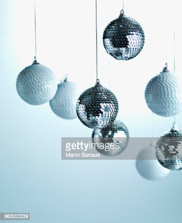 Christmas ornaments hanging from string : Stock Photo