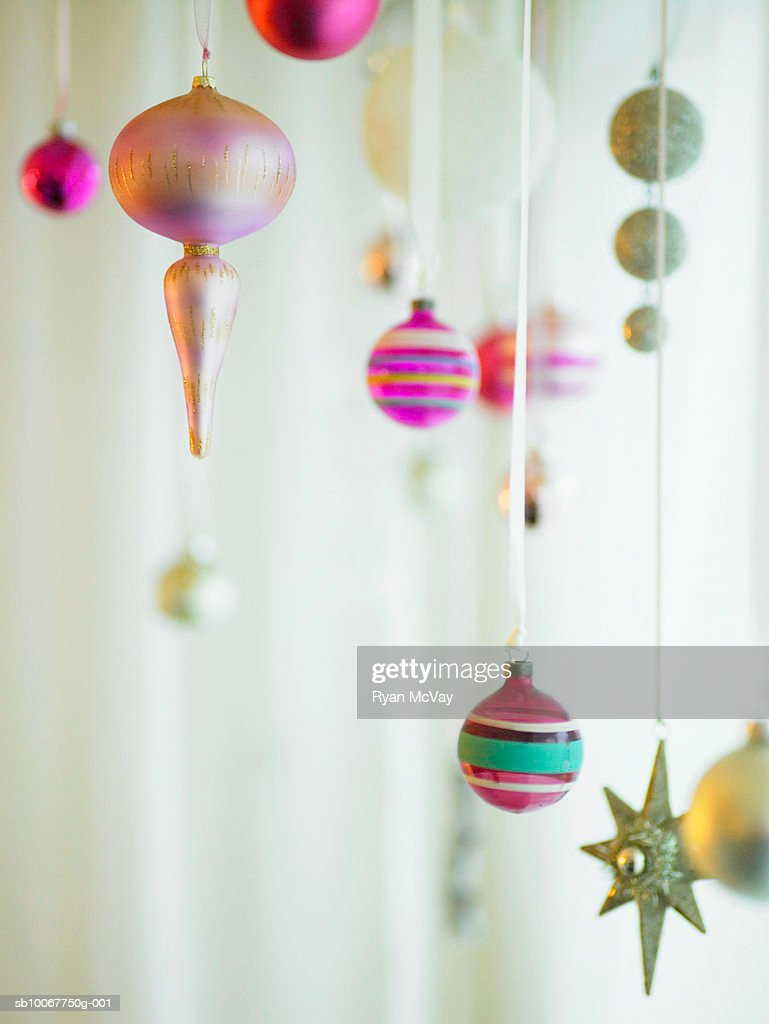 Christmas ornaments hanging from strings : Stock Photo
