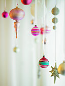 Christmas ornaments hanging from strings
