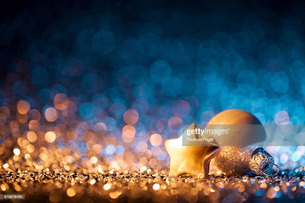 Christmas ornaments on defocused lights decorations bokeh for Blue and gold christmas