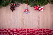 Christmas ornaments with red ribbon, pine tree and cones