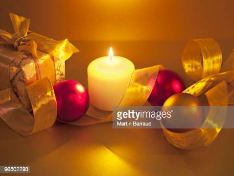 Christmas ornaments with ribbon and candle : Stock Photo