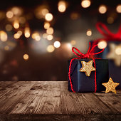 Christmas package with festive background lights and bokeh