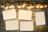 Blank photo frame album - empty old instant photos paper on wood table in christmas. vintage and retro style
