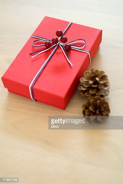 Christmas present and pine cones