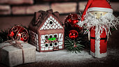 Christmas present on the background of a gingerbread house.photo with copy space