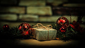 Christmas present on the background of Christmas decorations.photo with copy space