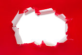 This is a photo of a ripped open red present.