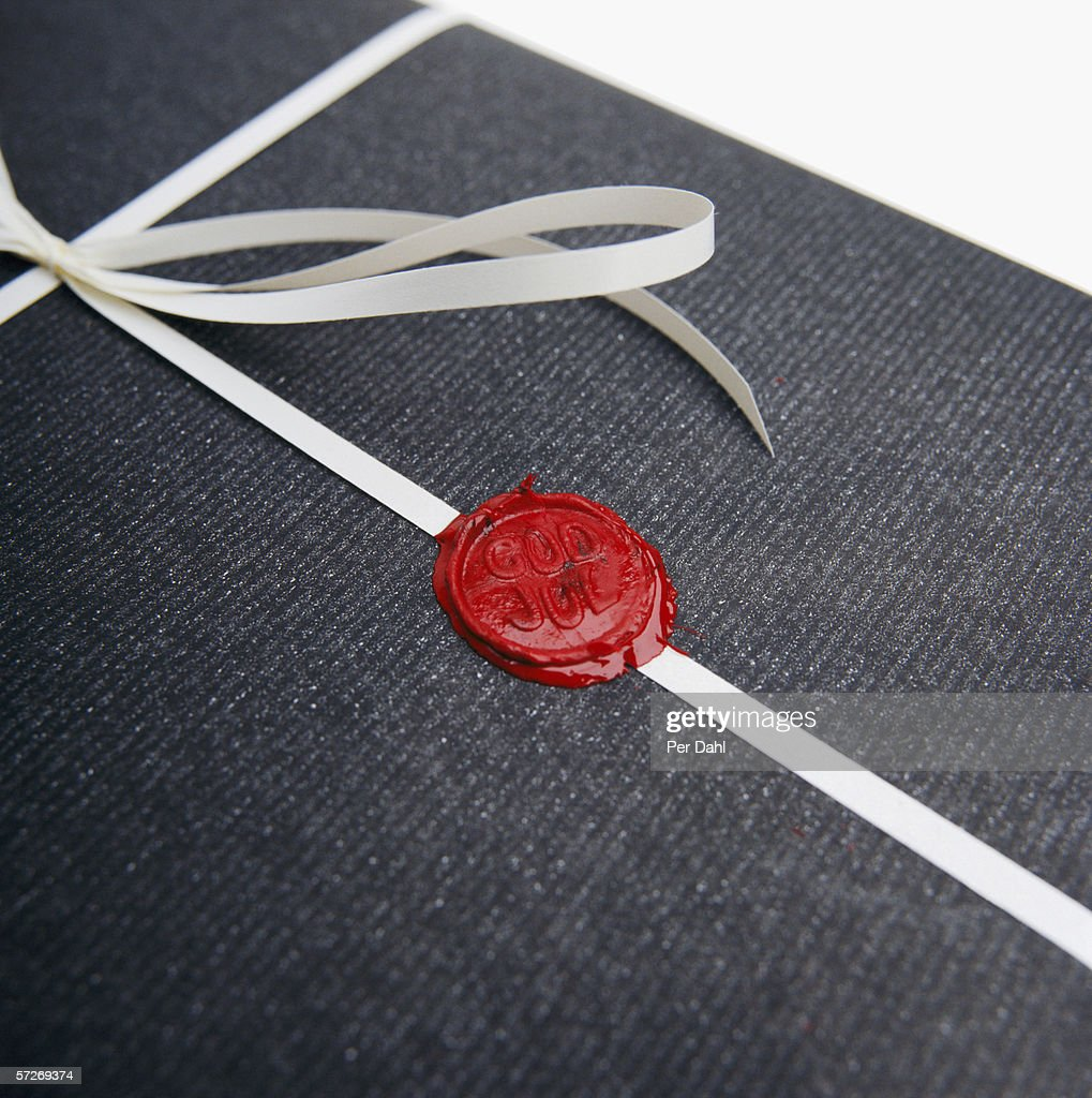 A Christmas present with red sealing wax.