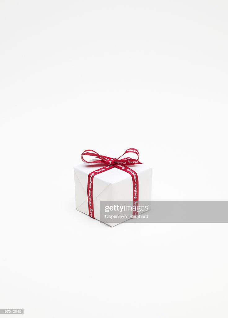 christmas present wrapped up in white paper : Stock Photo