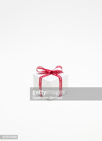 christmas present wrapped up in white paper : Foto de stock