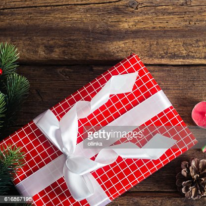 Christmas presents on a wooden background with candy cane : Stock Photo
