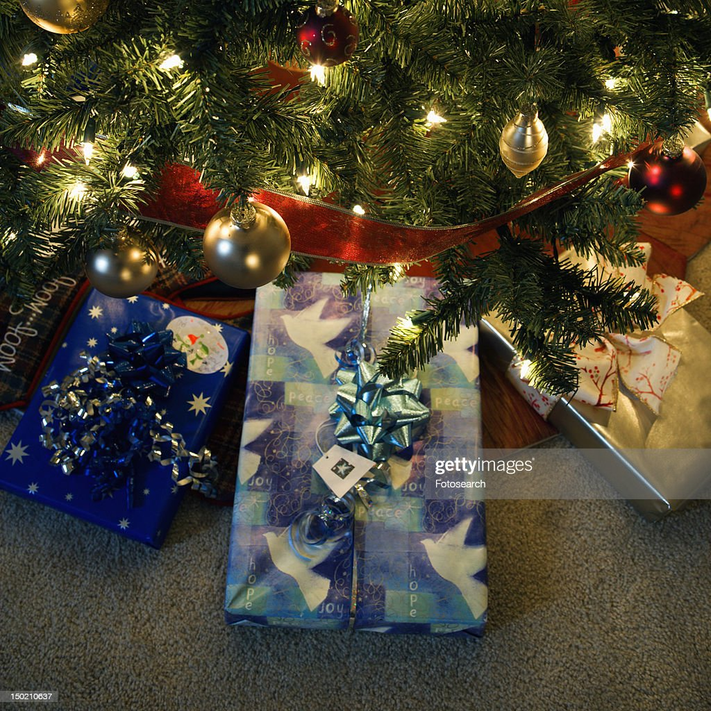 Christmas presents under decorated Christmas tree : Stock Photo