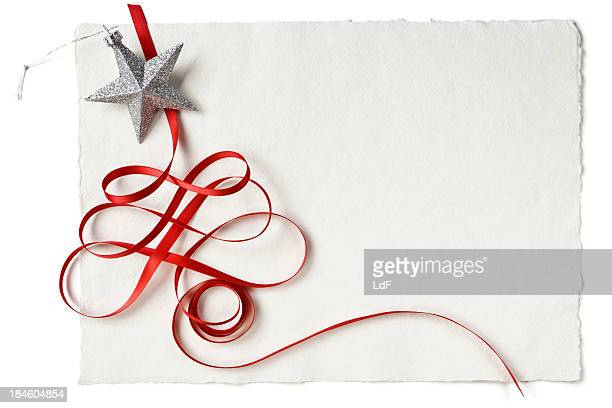 Christmas red ribbon and star on handmade paper