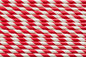 Christmas red straws as background. Holiday card. Top view. Pattern
