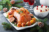 Christmas roast duck with baked potatoes, selective focus