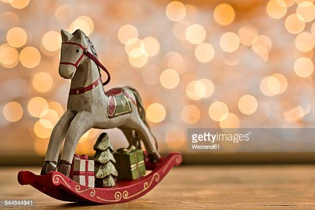 Christmas rocking horse in front of points of light