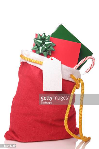 Christmas sack filled with candy cane card and gift with bow