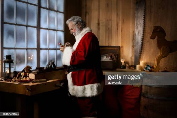 Christmas Santa Claus Working in His Toy Workshop, Copy Space