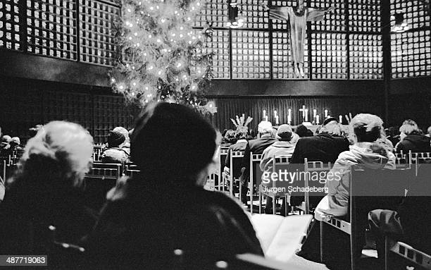A Christmas service in the Gedächtniskirche or Kaiser Wilhelm Memorial Church in Berlin Germany circa 1967