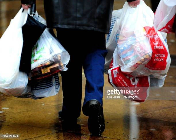 A Christmas shopper carries bags at Cooper's Square in Burton On Trent Staffordshire