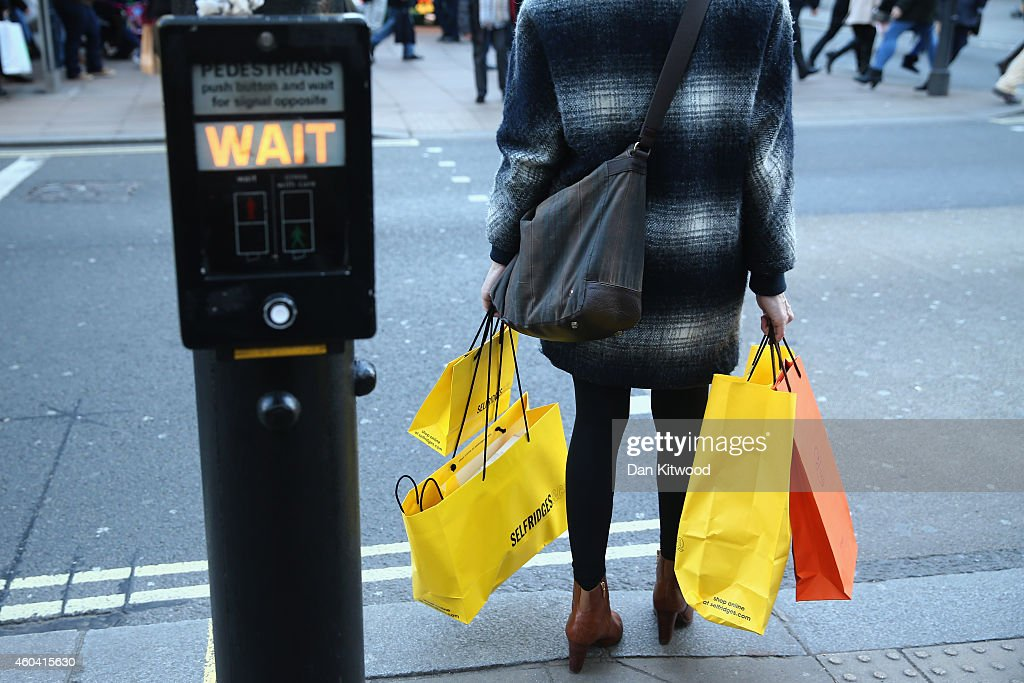 Christmas shopper carries her shopping bags as shoppers crowd Oxford Street on December 13 2014 in London England Retailers across the UK are hoping...