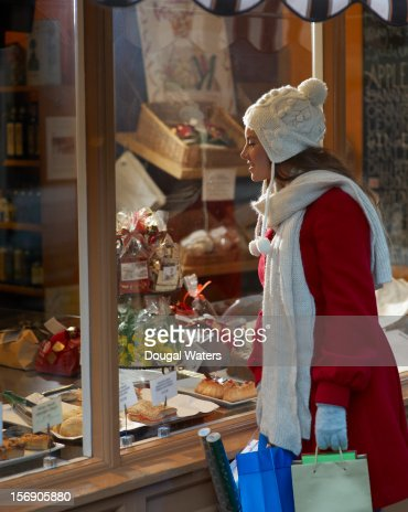 Christmas shopper looking into shop window. : Stock Photo