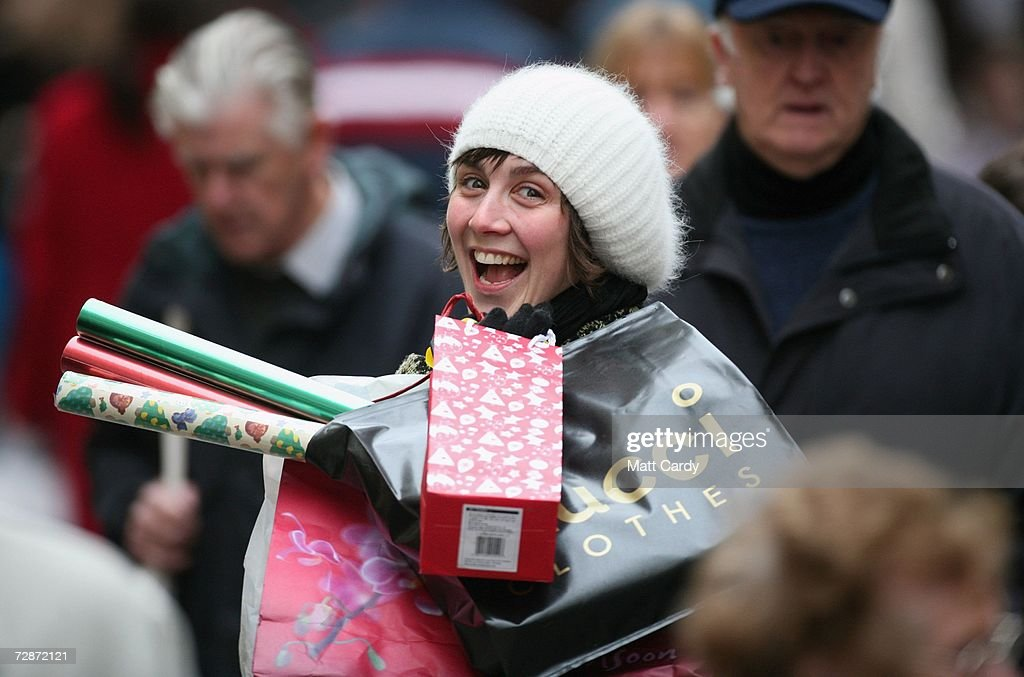 A Christmas shopper makes her away along the High Street on December 23, 2006 in Bath, England. With just two days to go before Christmas, the streets are busy with people as they are finishing their last-minute Christmas shopping.
