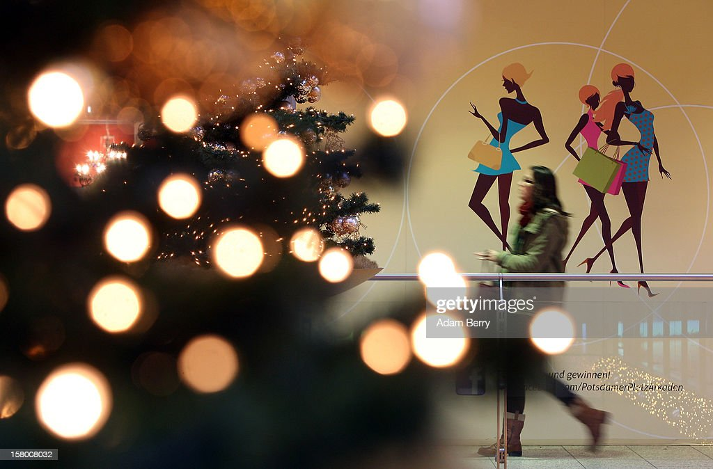 A Christmas shopper passes through a shopping mall on December 8, 2012 in Berlin, Germany. German consumer confidence dropped prior to the Christmas season from a high level, according to a survey released at the end of November, expecting to harm retail sales in December, but not to the point of hurting businesses greatly.
