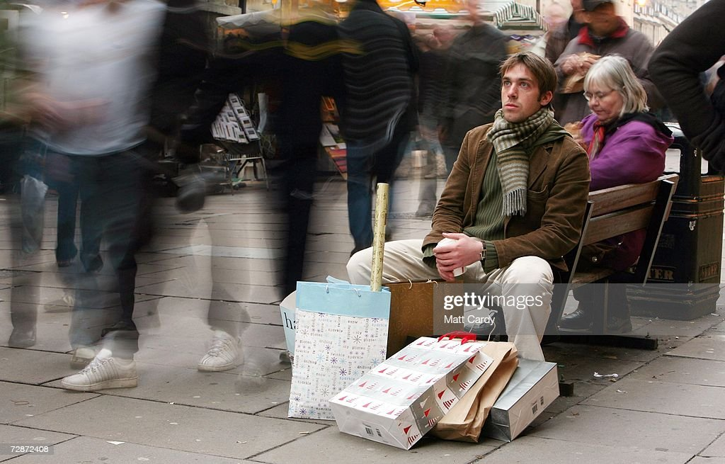 A Christmas shopper takes a break from shopping on December 23, 2006 in Bath, England. With just two days to go before Christmas, the streets are busy with people as they are finishing their last-minute Christmas shopping.