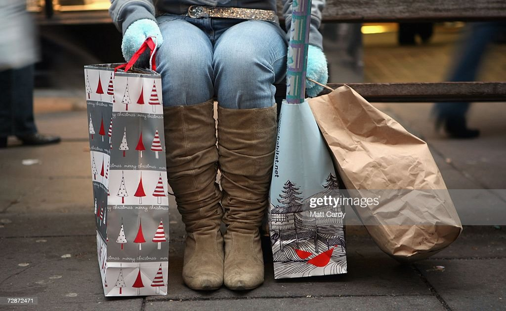A Christmas shopper takes a break from their shopping spree on December 23, 2006 in Bath, England. With just two days to go before Christmas, the streets are busy with people finishing their last-minute Christmas shopping.
