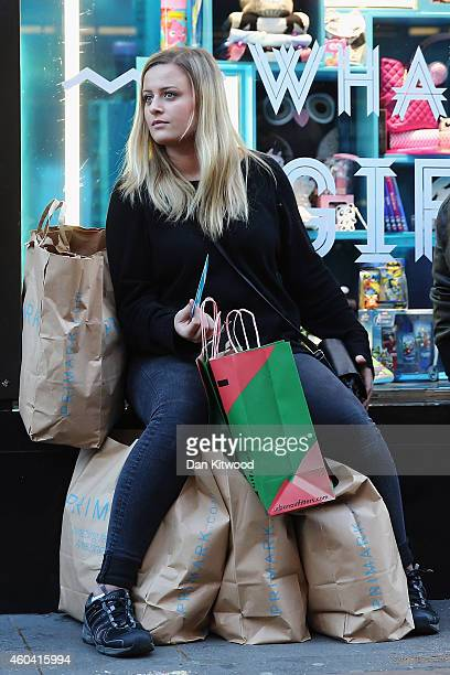 Christmas shopper takes a break on Oxford Street on December 13 2014 in London England Retailers across the UK are hoping for strong Christmas season...