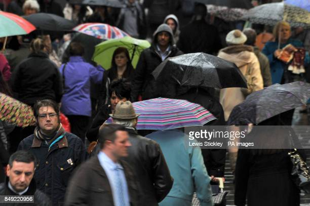 Christmas shoppers brave the bad conditions as wet weather sweeps across Nottingham City Centre PRESS ASSOCIATION Photo Picture date Thursday...