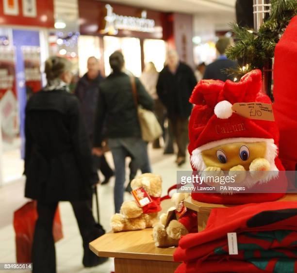 Christmas shoppers browse shops in Scotland's capital city Edinburgh