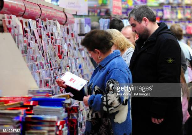 Christmas shoppers buying cards at Coppers Square Burton On Trent Stafforddhire
