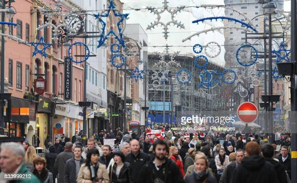 Christmas shoppers in the streets of Leeds City centre today one week before Christmas Day