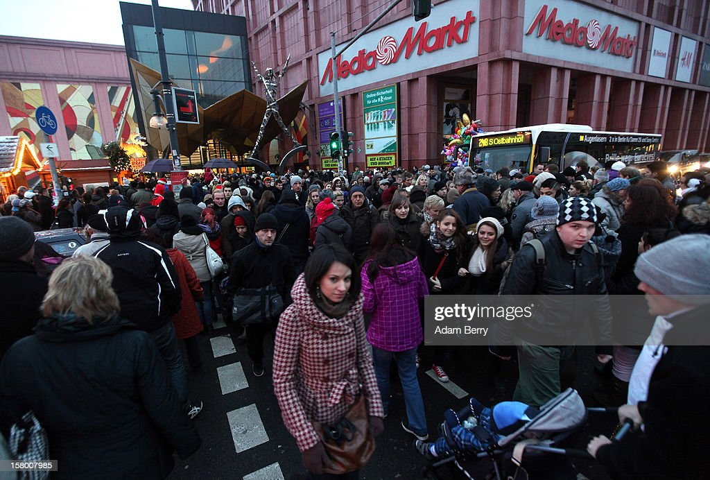 Christmas shoppers leave a shopping mall in front of a Media Markt store on December 8, 2012 in Berlin, Germany. German consumer confidence dropped prior to the Christmas season from a high level, according to a survey released at the end of November, expecting to harm retail sales in December, but not to the point of hurting businesses greatly.