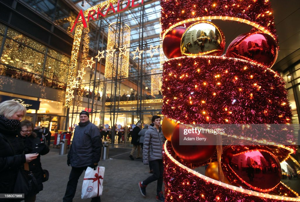 Christmas shoppers leave a shopping mall on December 8, 2012 in Berlin, Germany. German consumer confidence dropped prior to the Christmas season from a high level, according to a survey released at the end of November, expecting to harm retail sales in December, but not to the point of hurting businesses greatly.