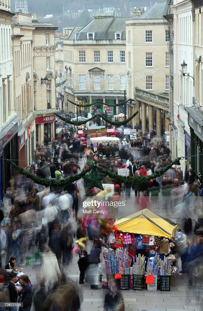 Christmas shoppers make their away along the high street on December 23, 2006 in Bath, England. With just two days to go before Christmas, the streets are full of people as they are finishing their last-minute Christmas shopping.