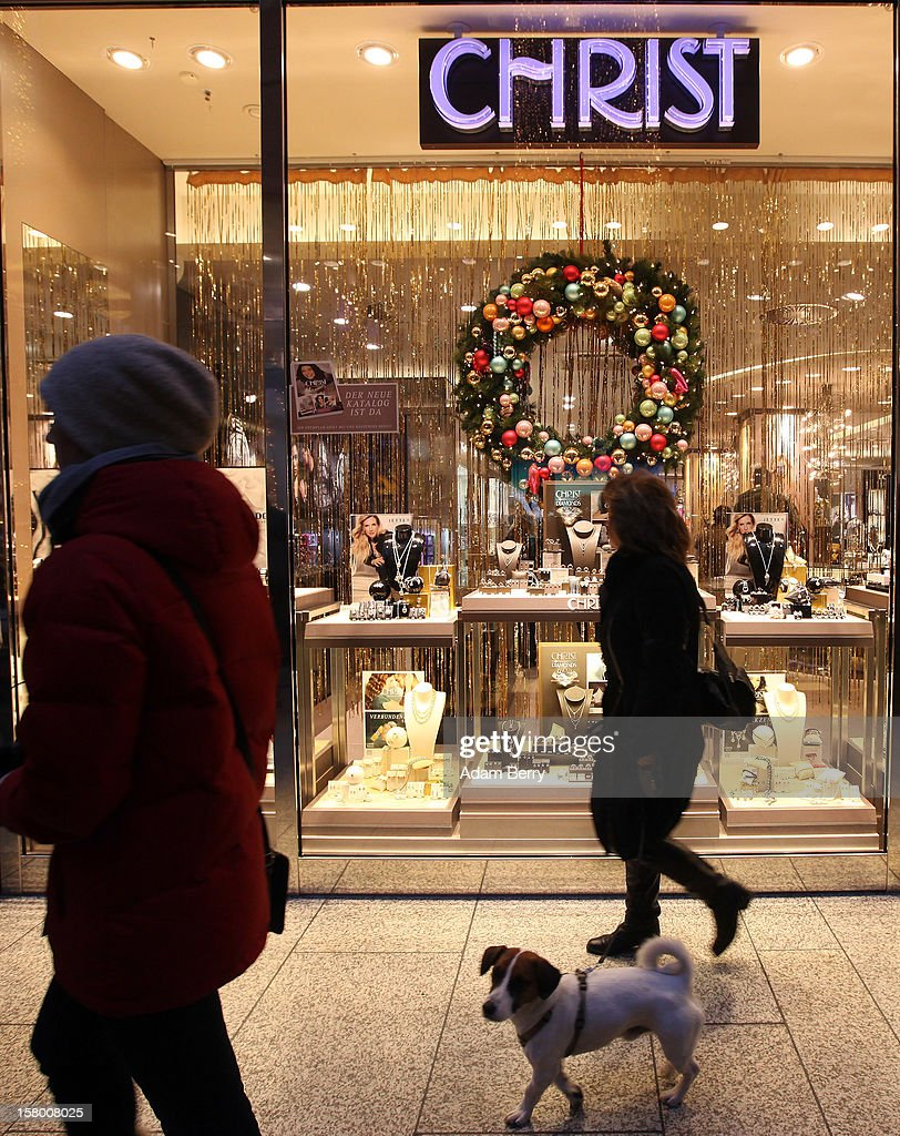 Christmas shoppers pass a Christ jewelry store in a shopping mall on December 8, 2012 in Berlin, Germany. German consumer confidence dropped prior to the Christmas season from a high level, according to a survey released at the end of November, expecting to harm retail sales in December, but not to the point of hurting businesses greatly.
