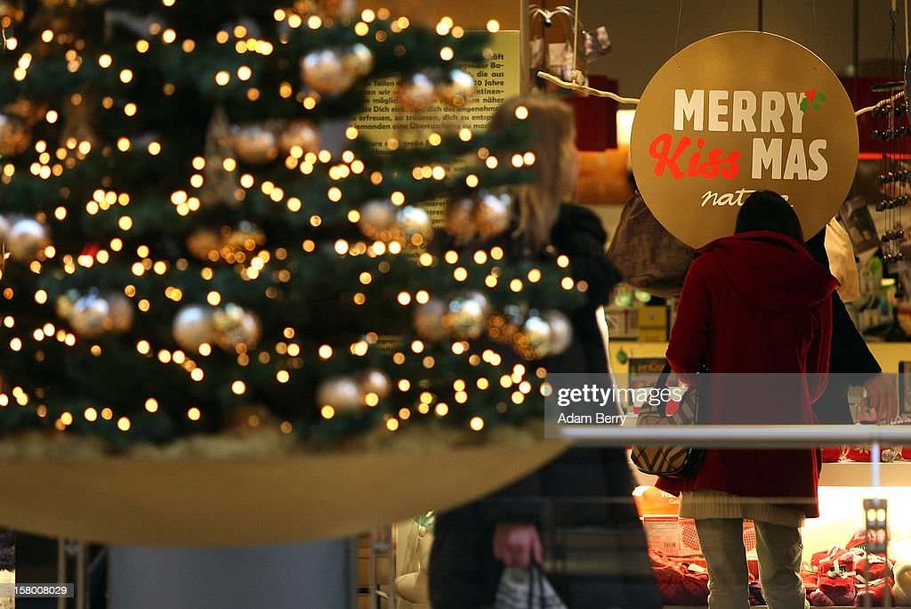 Christmas shoppers pass through a shopping mall on December 8, 2012 in Berlin, Germany. German consumer confidence dropped prior to the Christmas season from a high level, according to a survey released at the end of November, expecting to harm retail sales in December, but not to the point of hurting businesses greatly.