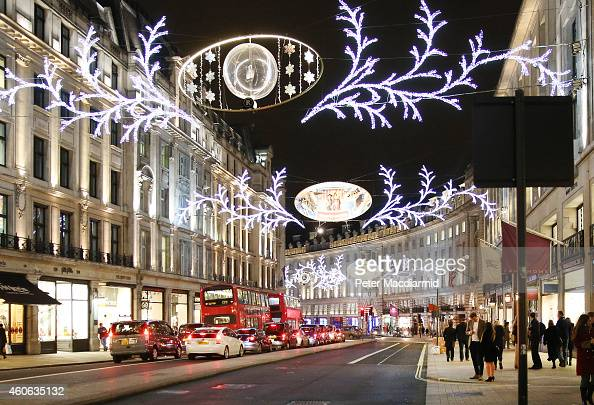 Christmas shoppers walk along Regent Street on December 16 2014 in London England Christmas is an annual religious feast day originally set on...