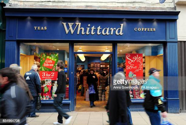 Christmas shoppers walk past a Whittard of Chelsea in York city centre