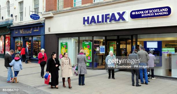 Christmas shoppers walk past a Whittard of Chelsea's and a branch of Halifax York city centre