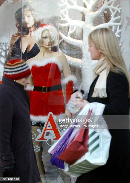 Christmas shoppers walk past Ann Summers on Princes Street in Edinburgh after a survey by theology think tank Theos found that the Spirit of...