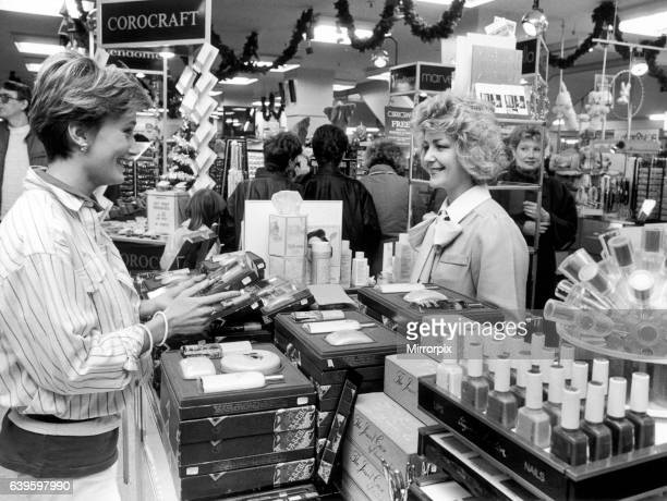 Christmas shopping at Owen Owen department in Coventry Gift packs of toiletries and perfumes are always popular 9th November 1985